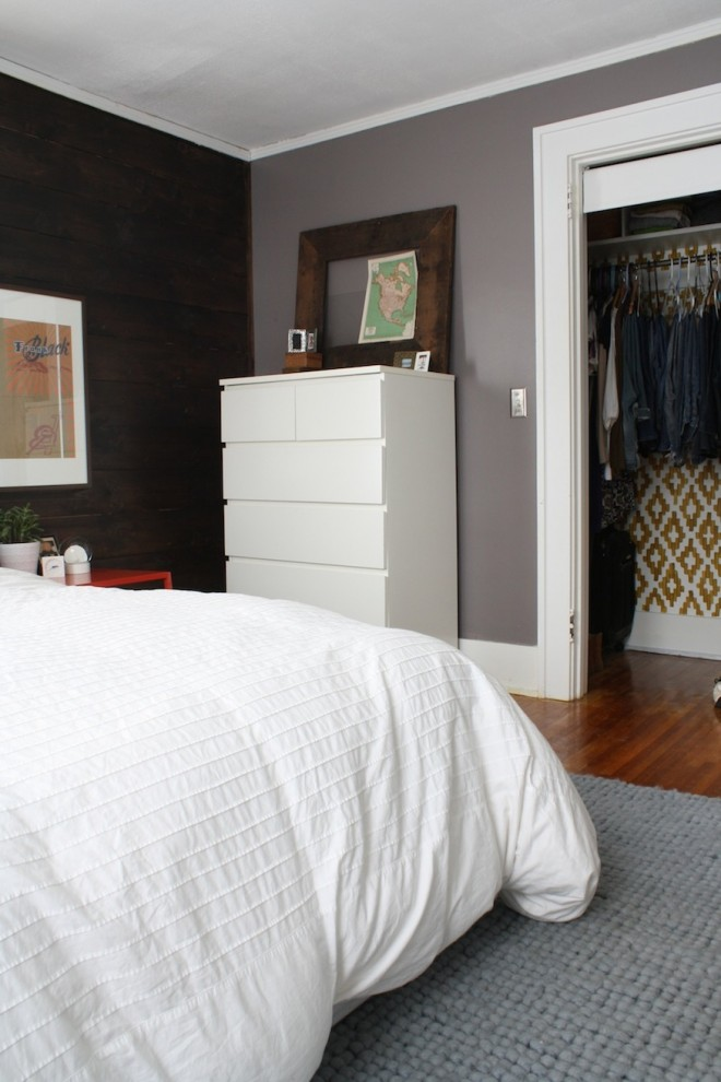 My modernized master bedroom with hardwood floors, an accent wall, and warm, cozy colors. The closet is handpainted ikat, and additional drawers are from IKEA.