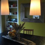 Lovely, dimmed-down pendant lights in the dining room.