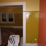 One dining room wall that transitions into the kitchen was painted to match the living room.