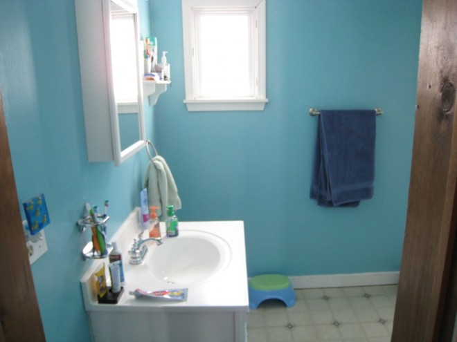 Our bathroom with, technically, the previous homeowners belongings. Tiny towel rack, small vanity, crazy colors.