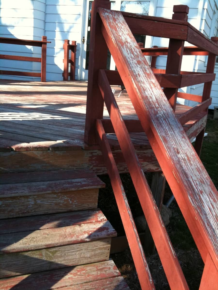 Close-up of the old deck's handrail and deck surface.