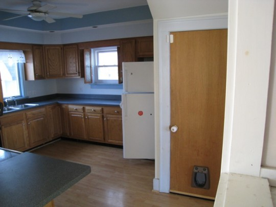 Kitchen, empty on move-in day.