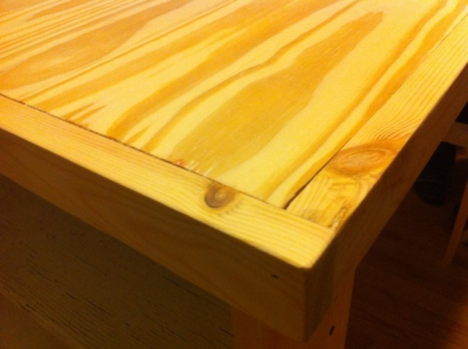 "Close-up of the tabletop (made of tongue-and-groove floorboards and 1""x2"" trim)"