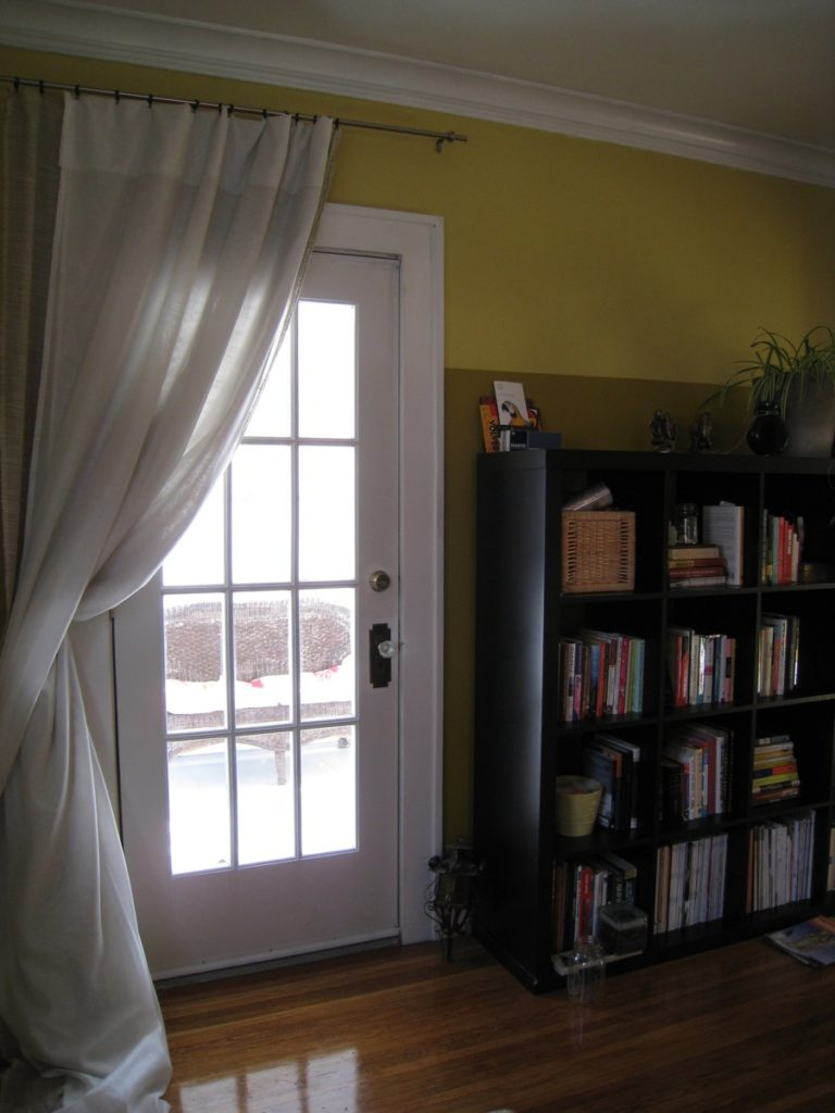 Completed, painted door. Curtain hangs over it during the winter as an extra layer of insulation, and for privacy in evenings during the summer.