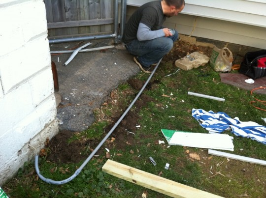 Reinforcing garage electrical wires with conduit piping.