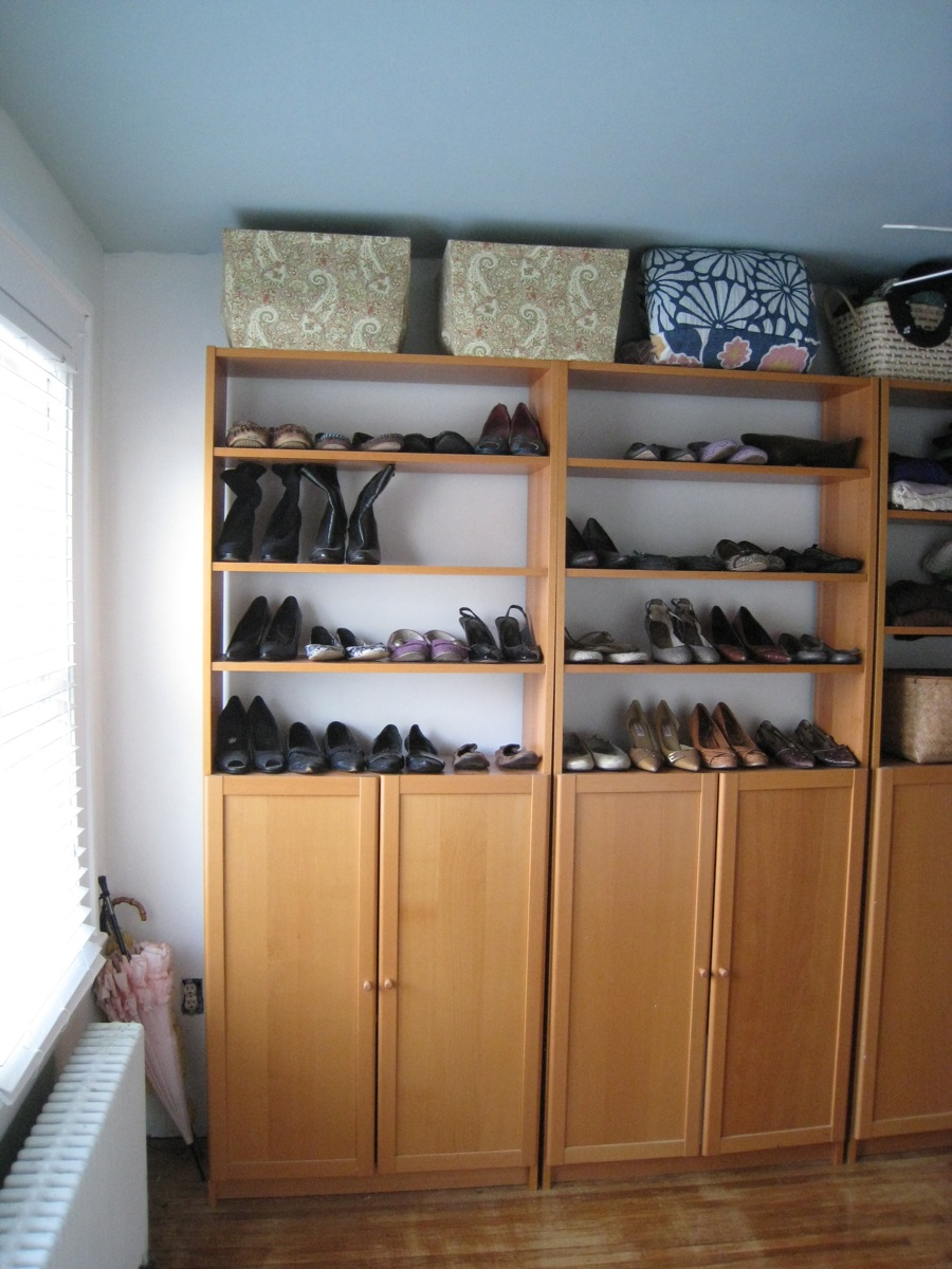 Matching IKEA cabinets flank one wall. Shown featuring my fall shoe collection, the sandals and other spring footwear are carefully stored in overhead baskets.