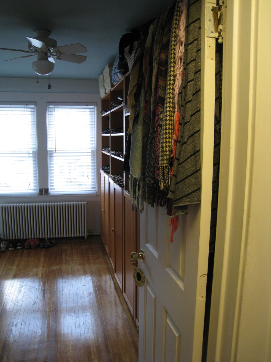 Entryway to the new walk-in-closet. Blue ceiling, white walls, and shiny finished hardwoods.