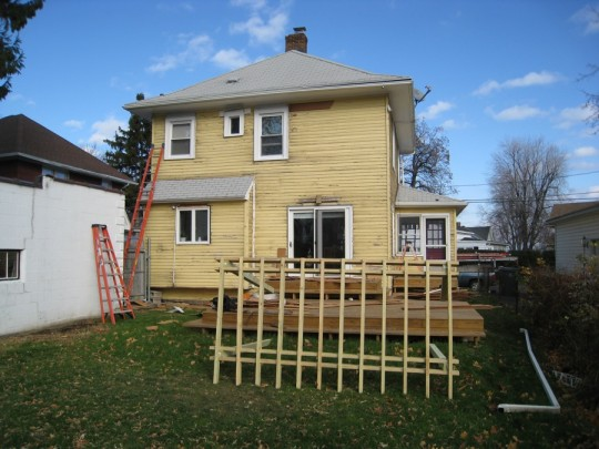 Siding, and pergola removed from the back of the house.