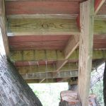 Treehouse platform from below - the red boards were actually the upward facing boards on the old deck.