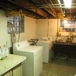 Southeast corner with the washer, dryer, and sink.