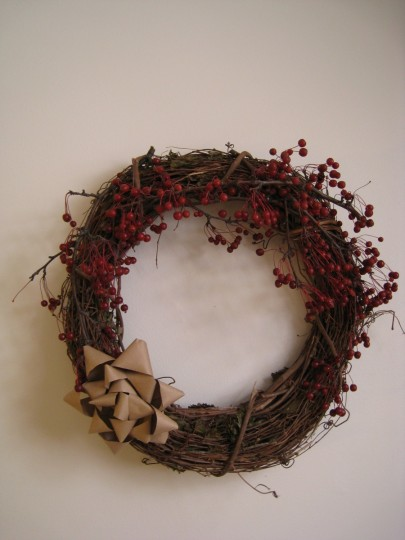 The finished wreath with real berries and handmade bow.