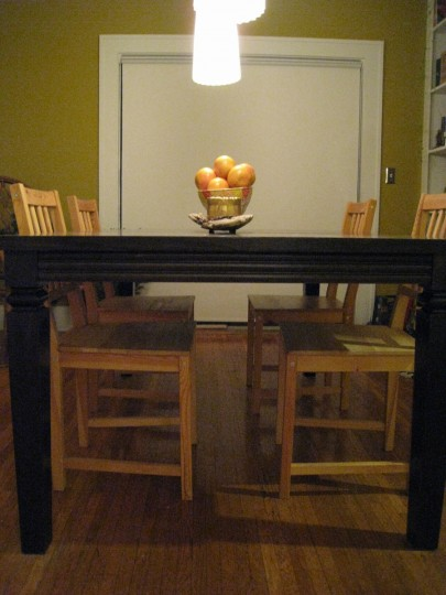 Dining room table (with sliding glass door and roller blind in the background)