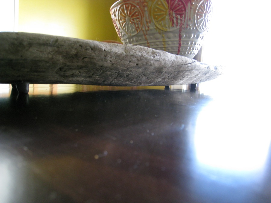 Final centerpiece, with Sugru silicone feet supporting the wood from the table. Bowl from Anthropologie. :)