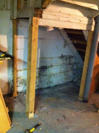 The new, cleared out and supported area beneath the basement stairs.