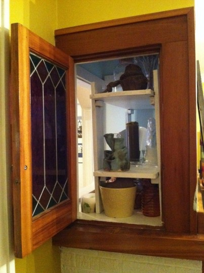 Leaded glass door that opens into the living room. Second access point to my new one-stop-shop.