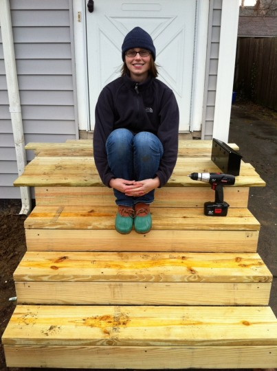 Me. And the front porch. Sans railings and even boards up on the landing, but yes. It's strong and solid and exists. Happy!