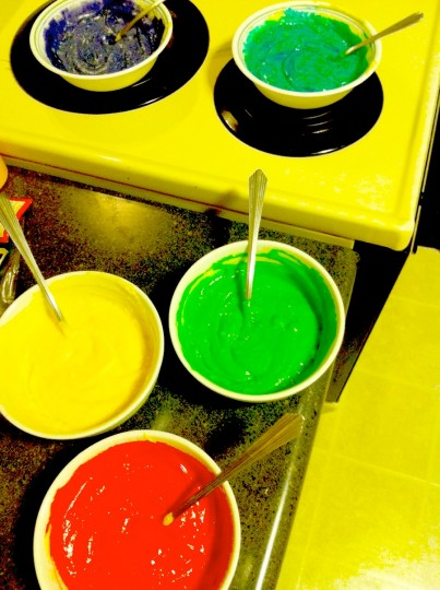 Mixing cupcake batter. With one... single... drop of potent food coloring.