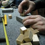 Hand sanding the spacers that will fit between each slat.