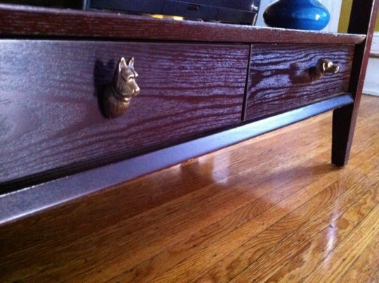 Dog drawer pulls installed on the TV stand.