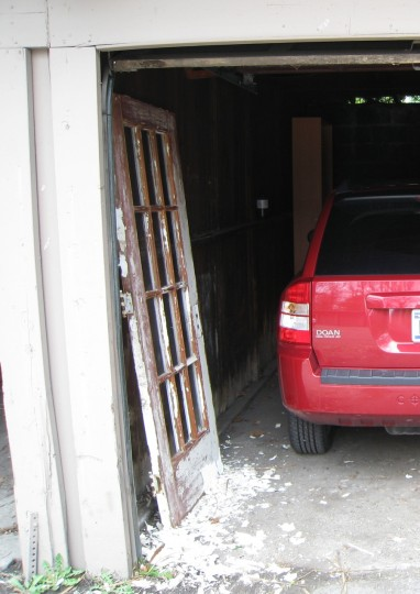 New old door and Jeepster fighting for space in the apartment garage. Check out how much I had already removed and let fall to the ground in this photo. I'm so messy.