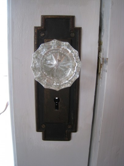 A lovely glass knob, borrowed from an upstairs closet door. I'd rather have it in a more visible place.