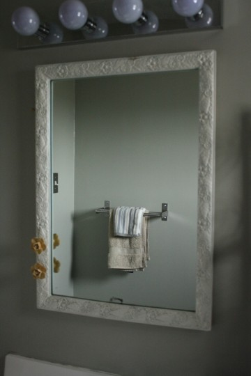 A new bathroom mirror, and the reflection of a small IKEA towel rack.