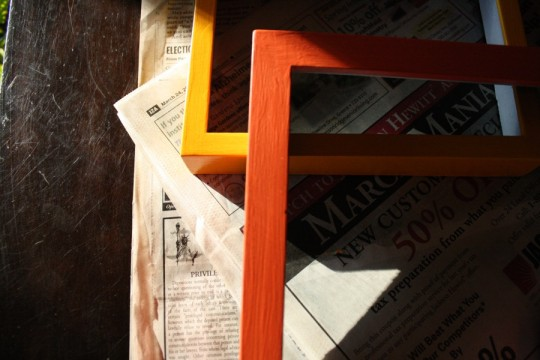 Applied coats of sample paint. The yellow frame has been spray-glossed while the darker orange one has not yet, just for comparative purposes..