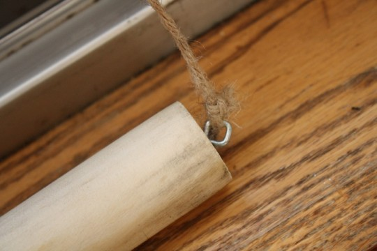 Eyelet hook in a dowel.