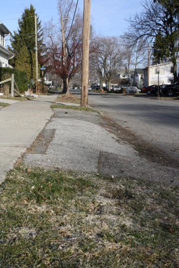 The curb. In bad condition.