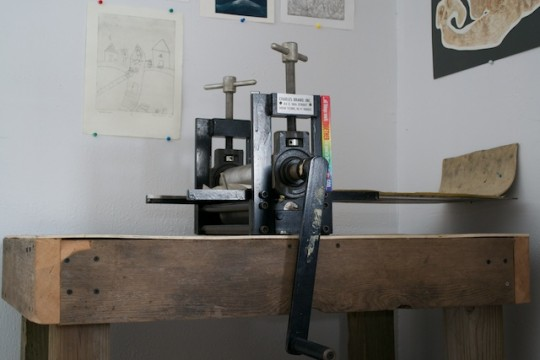 A press, on the top of a custom-built work table. Reminds me of my DIY gardening table! Love a good upcycle.