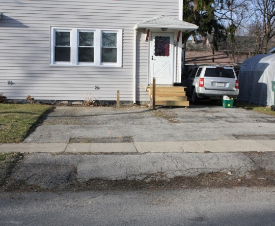 This is a really bad driveway. Crumbling, dipping, cracking, and patchy.