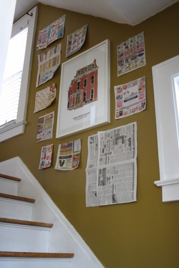 A little stairwell newspaper collage helped to get the frame placement in order.
