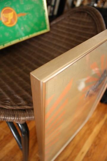 Goldie-brassy frame edge.