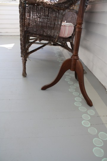 Dots under the chair legs.
