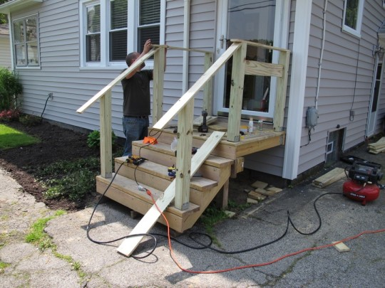 Front porch with new upper hand rails... looking level so far!
