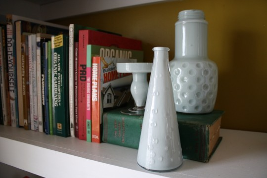 Jars and vases on the bookshelf. How's that for milky glass?