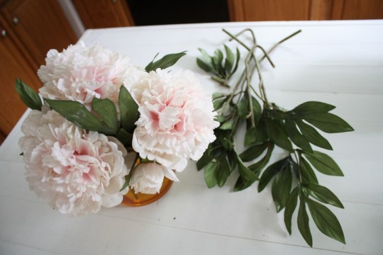 Shortened the faux-peonies with the help of some wire cutters.