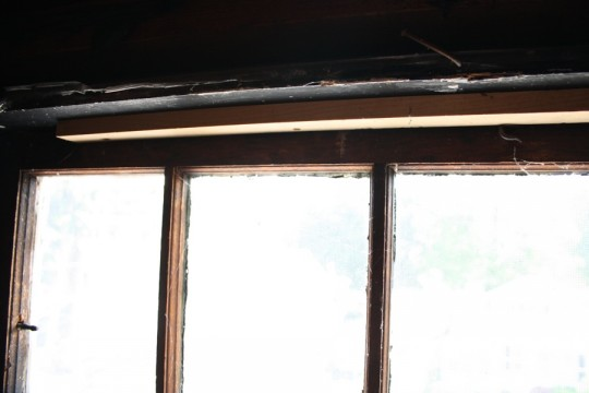 A window blockade - a board screwed into the frame to hold the pane pinned in place.