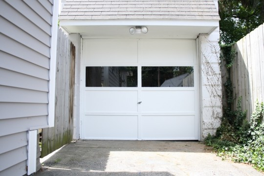 Garage door looking spiffy clean. But notice, to the right of the door, I still owe some Porpoise Gray paint.