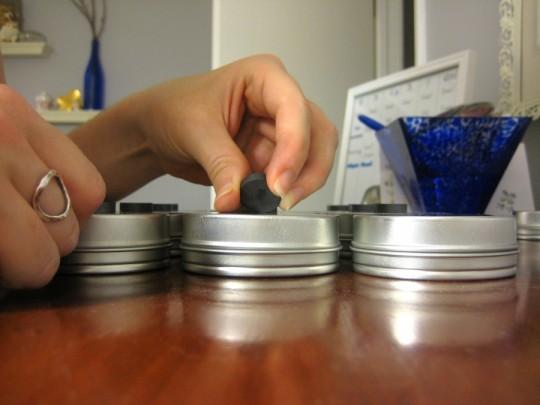 Katrina assembling spice tins.