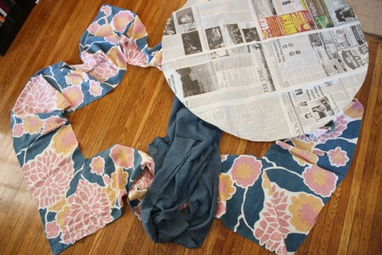 "Extra strips of salvaged quilt fabric, and a 36"" circle template made from newspaper."