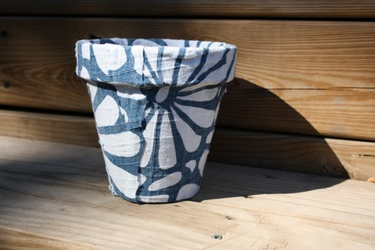A fabric covered pot.