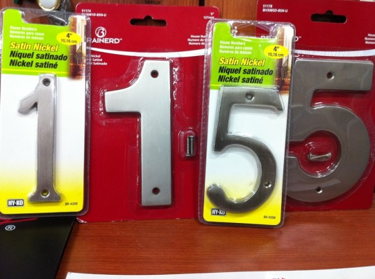 Weighing pros and cons of two house number styles.
