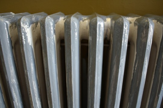 Radiator paint close-up. One coat on, lots of intricate painting work to go.