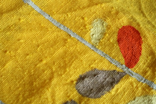 Beginning the Orla Kiely pattern on the yellow napkin canvas.
