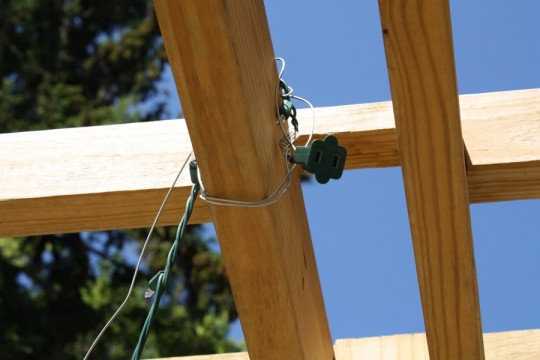 The end of the light strand attached to the pergola.