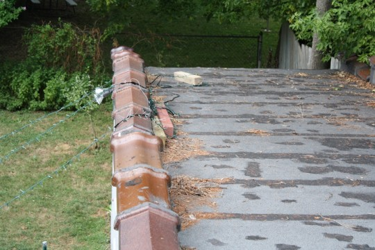 """The wire that held the strands in place wrapped around 4""""x4"""" boards on the garage roof to act as anchors."""