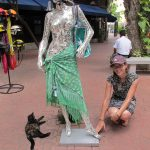Feral cat, sparkly woman wearing a cool non-DOC-approved helmet, and me.