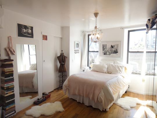 Apartment Therapy, #2. Pretty bed between windows anchored with large art (and a great light).
