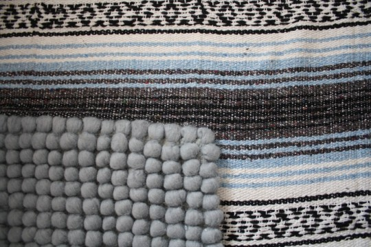 "How about a close-up of the overlapping West Elm Pebble Rug and Mexican ""rug""?"